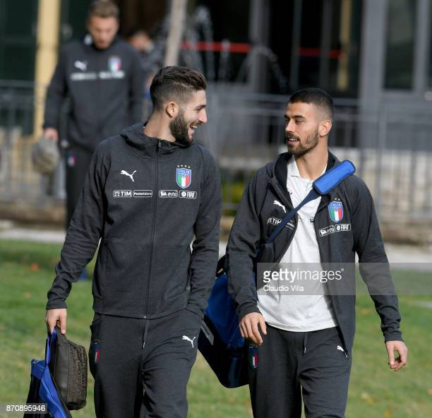 Roberto Gagliardini and Leonardo Spinazzola of Italy chat prior to the training session at Italy club's training ground at Coverciano on November 6...