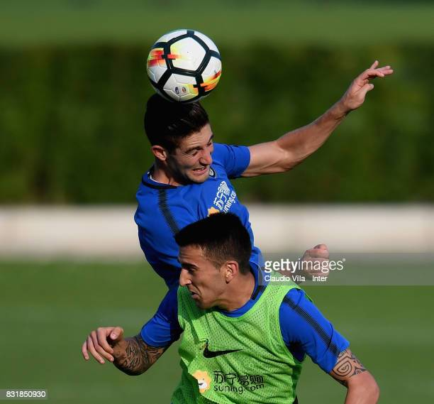Roberto Gagliardini and Matias Vecino of FC Internazionale compete for the ball during a training session at Suning Training Center at Appiano...