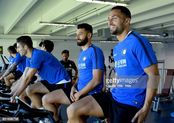 Roberto Gagliardini Antonio Candreva and Danilo D'Ambrosio of FC Internazionale in action during a training session at Suning Training Center at...