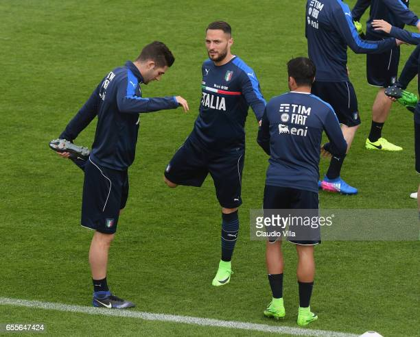 Roberto Gagliardini Danilo D'Ambrosio and Eder of Italy chat during the training session at the club's training ground at Coverciano on March 20 2017...