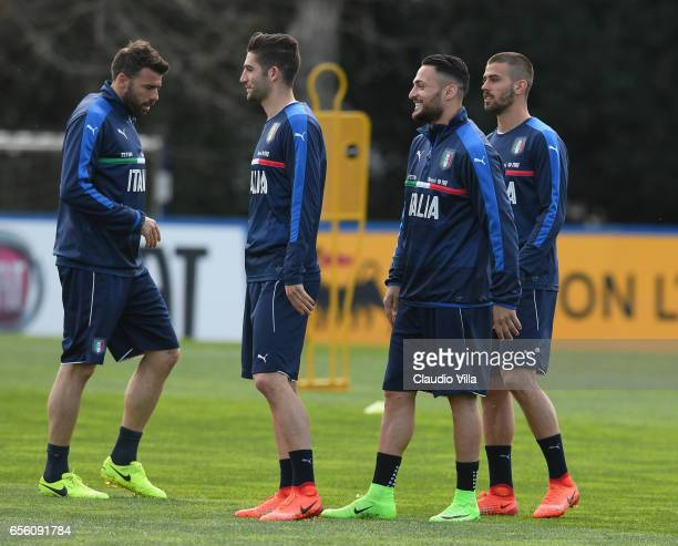 Roberto Gagliardini Danilo D'Ambrosio and Leonardo Spinazzola of Italy look on during the training session at the club's training ground at...