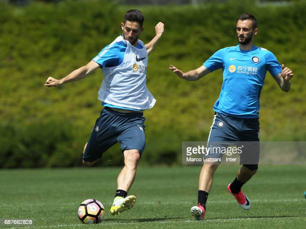 Roberto Gagliardini is challenged by Marcelo Brozovic during the FC Internazionale training session at the club's training ground Suning Training...