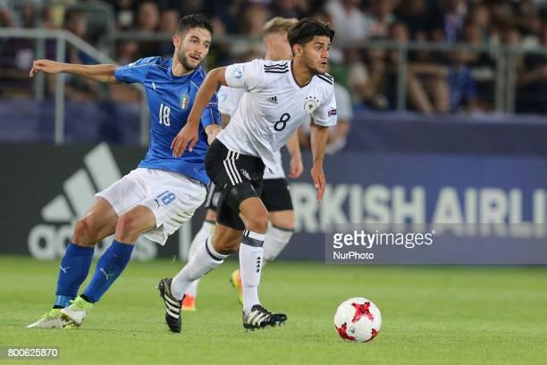 Roberto Gagliardini Mahmoud Dahoud during the UEFA U21 European Championship Group C football match Italy v Germany in Krakow Poland on June 24 2017