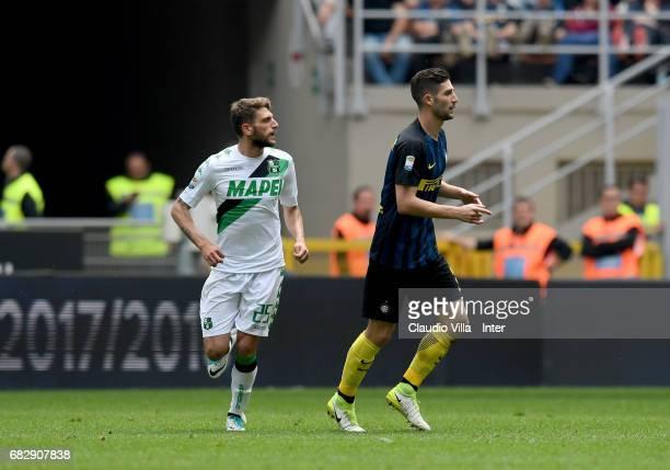 Roberto Gagliardini of FC Internazionale and Domenico Berardi of US Sassuolo during the Serie A match between FC Internazionale and US Sassuolo at...