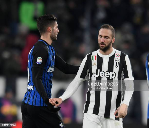 Roberto Gagliardini of FC Internazionale and Gonzalo Higuain of Juventus FC chat at the end of the Serie A match between Juventus and FC...