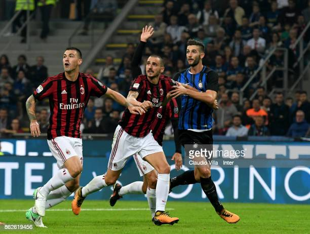 Roberto Gagliardini of FC Internazionale and Leonardo Bonucci of AC Milan compete for the ball during the Serie A match between FC Internazionale and...