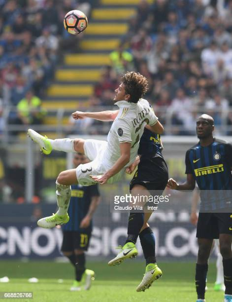 Roberto Gagliardini of FC Internazionale and Manuel Locatelli of AC Milan compete for the ball during the Serie A match between FC Internazionale and...
