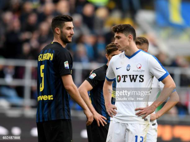 Roberto Gagliardini of FC Internazionale and Mattia Caldara of Atalanta BC compete during the Serie A match between FC Internazionale and Atalanta BC...