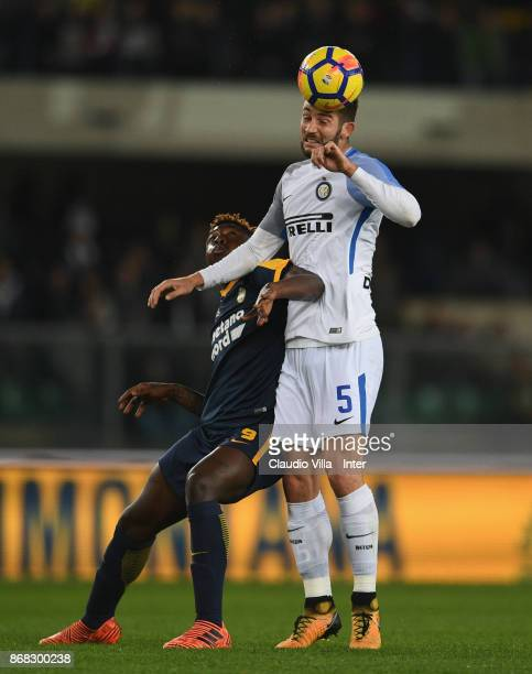 Roberto Gagliardini of FC Internazionale and Moise Kean of Hellas Verona FC compete for the ball during the Serie A match between Hellas Verona FC...