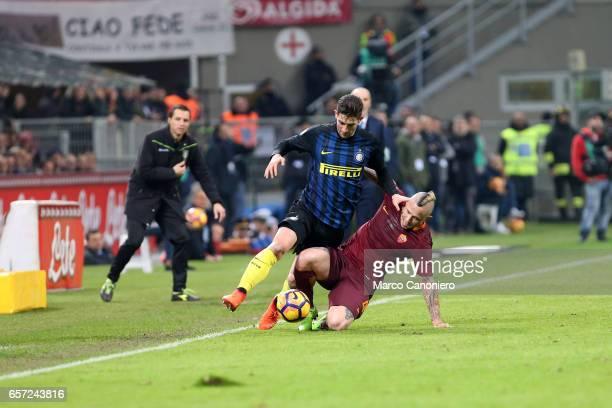 Roberto Gagliardini of FC Internazionale and Radja Nainggolan of AS Roma compete for the ball during the Serie A match between FC Internazionale and...