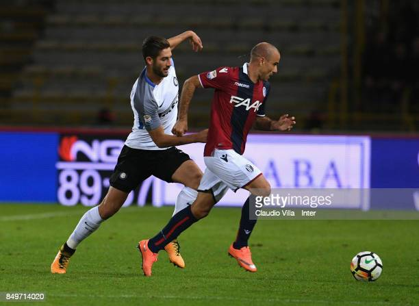 Roberto Gagliardini of FC Internazionale and Rodrigo Palacio of FC Internazionale compete for the ball during the Serie A match between Bologna FC...