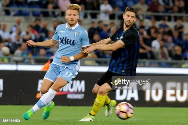 Roberto Gagliardini of FC Internazionale compete for the ball with Ciro Immobile of SS Lazio during the Serie A match between SS Lazio and FC...