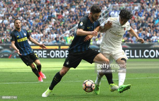 Roberto Gagliardini of FC Internazionale competes for the ball with Mati Fernandez of AC Milan during the Serie A match between FC Internazionale and...