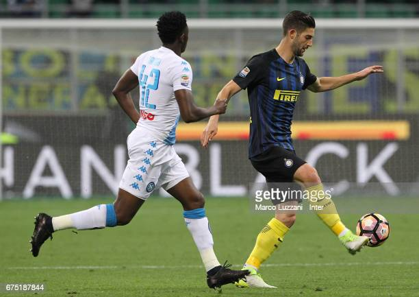 Roberto Gagliardini of FC Internazionale competes for the ball with Amadou Diawara of SSC Napoli during the Serie A match between FC Internazionale...