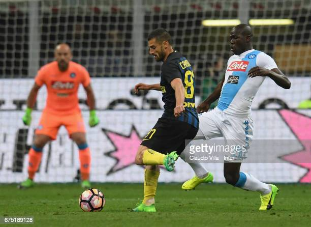 Roberto Gagliardini of FC Internazionale competes for the ball with Kalidou Koulibaly of SSC Napoli during the Serie A match between FC...