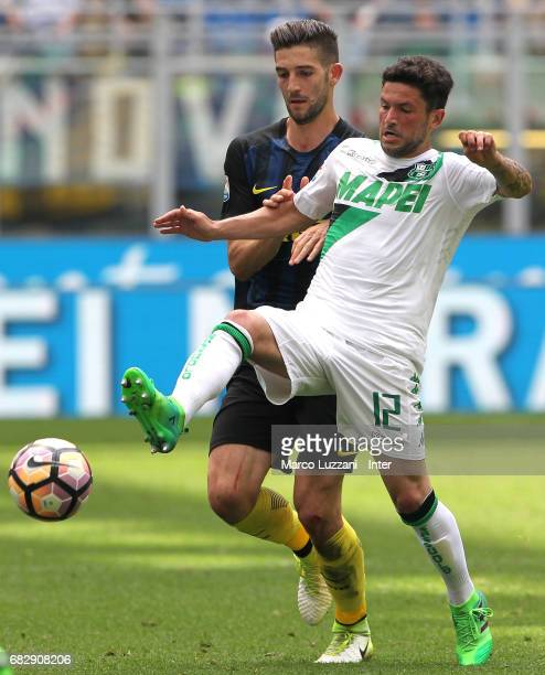 Roberto Gagliardini of FC Internazionale competes for the ball with Stefano Sensi of US Sassuolo during the Serie A match between FC Internazionale...