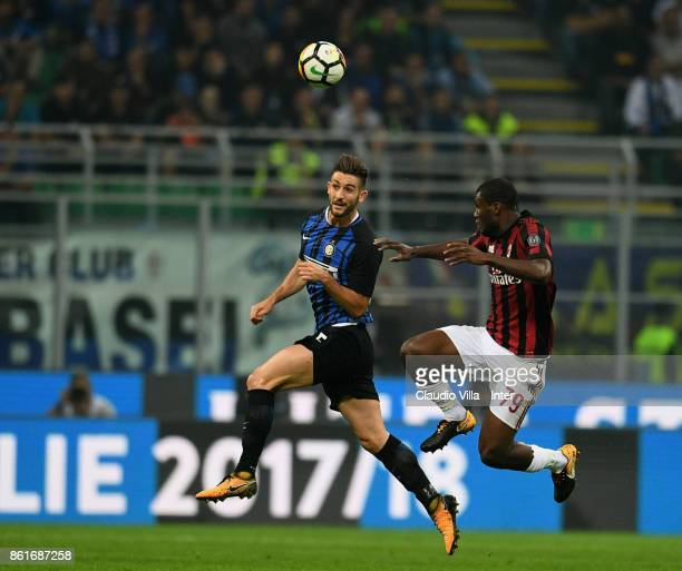 Roberto Gagliardini of FC Internazionale competes for the ball with Franck Kessie of AC Milan during the Serie A match between FC Internazionale and...