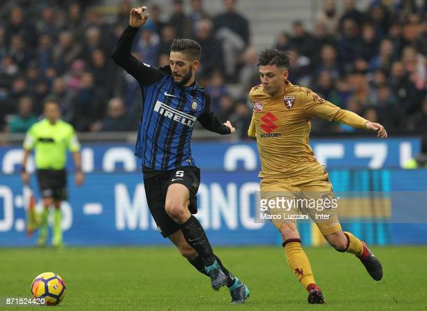 Roberto Gagliardini of FC Internazionale is challenged by Daniele Baselli of Torino FC during the Serie A match between FC Internazionale and Torino...
