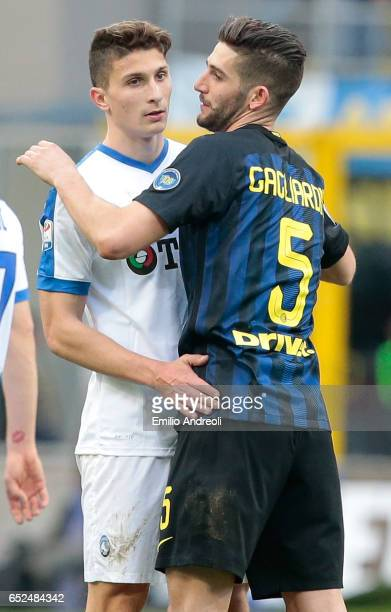 Roberto Gagliardini of FC Internazionale Milano embraces Mattia Caldara of Atalanta BC at the end of the Serie A match between FC Internazionale and...