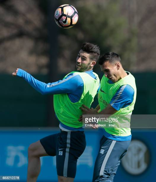Roberto Gagliardini of FC Internazionale Milano jumps for the ball with Trent Lucas Sainsbury during the FC Internazionale training session at the...