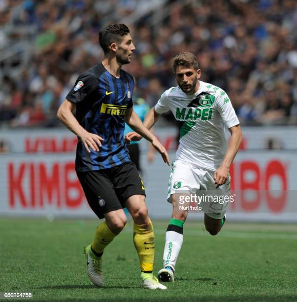 Roberto Gagliardini of Inter player and Domenico Berardi of Sassuolo player during the Serie A match between FC Internazionale and US Sassuolo at...