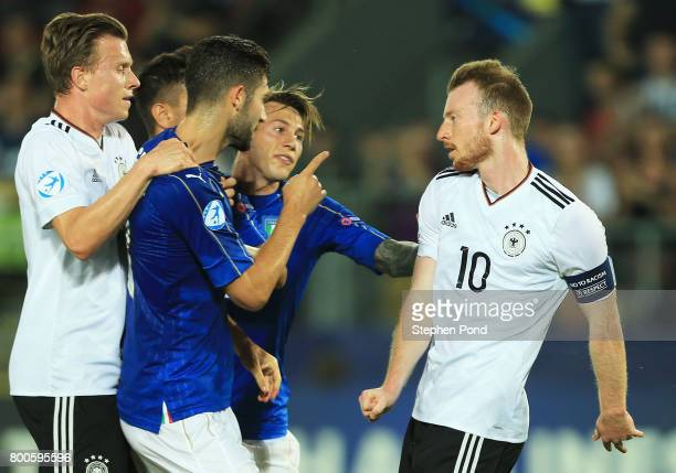 Roberto Gagliardini of Italy and Maximilian Arnold of Germany clash during the 2017 UEFA European Under21 Championship Group C match between Italy...