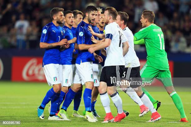 Roberto Gagliardini of Italy and Maximilian Arnold of Germany clash alongside team mates during the 2017 UEFA European Under21 Championship Group C...