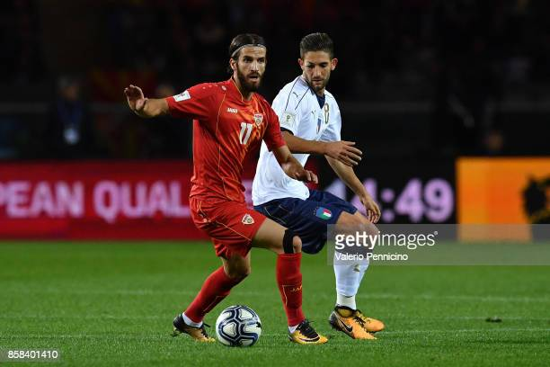 Roberto Gagliardini of Italy competes for the ball with Feran Hasani of FYR Macedonia during the FIFA 2018 World Cup Qualifier between Italy and FYR...