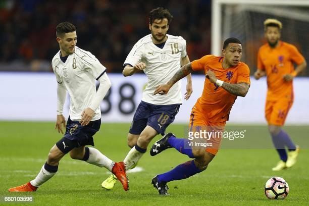 Roberto Gagliardini of Italy Marco Parolo of Italy Memphis Depay of Hollandduring the friendly match between Netherlands and Italy at the Amsterdam...