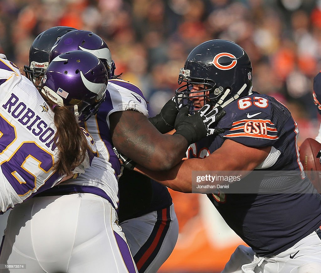 Roberto Garza #63 of the Chicago Bears blocks against the Minnesota Vikings at Soldier Field on November 25, 2012 in Chicago, Illinois. The Bears defeated the Vikings 28-10.