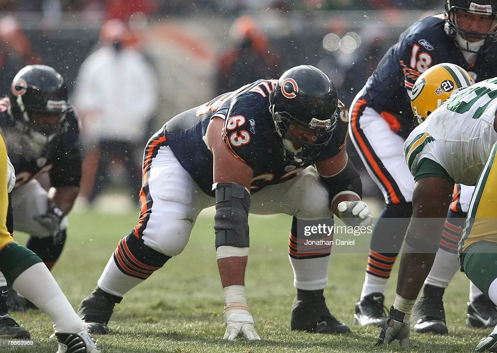 Roberto Garza #63 of the Chicago Bears crouches at the line of scrimmage against the Green Bay Packers on December 23, 2007 at Soldier Field in Chicago, Illinois.