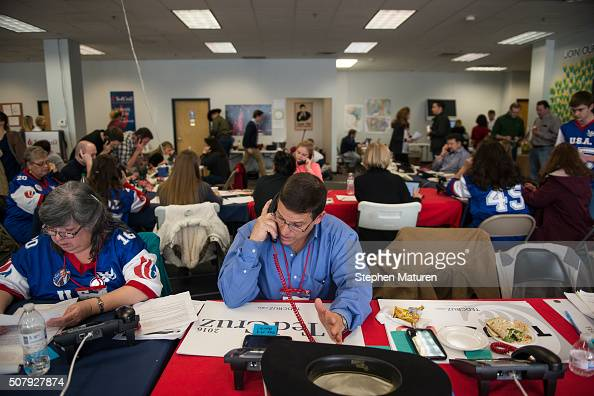 Roberto Gonzales center of League City TX makes calls on behalf of Republican presidential candidate Sen Ted Cruz at his headquarters in Urbandale...