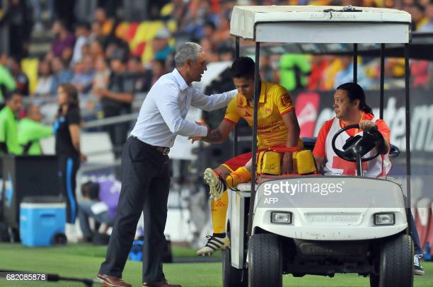 Roberto Hernandez coach of Morelia shakes hands with Raul Ruidiaz after he gets hurt in the match against Tijuana for the Mexican Clausura 2017...