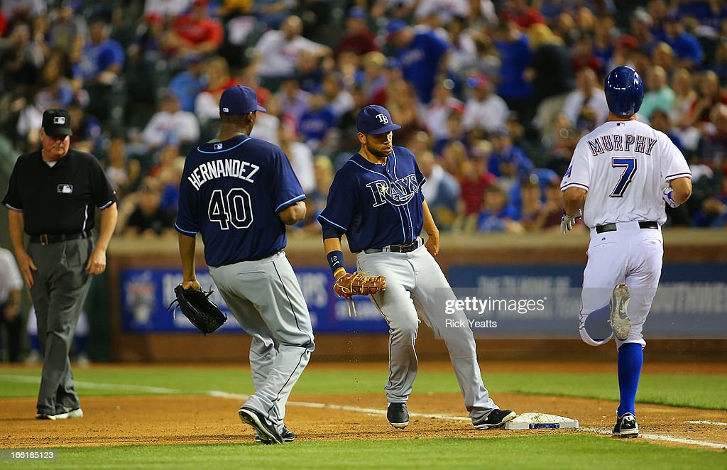 Roberto Hernandez #40 looks on as <a gi-track='captionPersonalityLinkClicked' href=/galleries/search?phrase=James+Loney&family=editorial&specificpeople=636293 ng-click='$event.stopPropagation()'>James Loney</a> #21 of the Tampa Bay Rays tags the base for the out on David Murphy #7 of the Texas Rangers at Rangers Ballpark in Arlington on April 9, 2013 in Arlington, Texas.