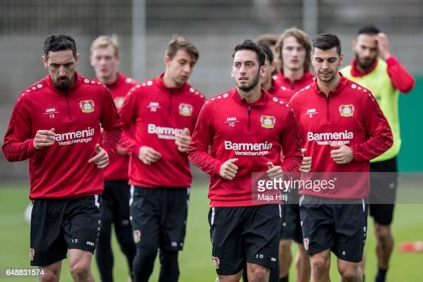 Roberto Hilbert Hakan Calhanoglu and Aleksandar Dragovic of Leverkusen run during the training on March 6 2017 in Leverkusen Germany