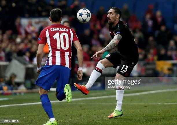 Roberto Hilbert of Bayer 04 Leverkusen in action against Yannick Carrasco of Atletico Madrid during the UEFA Champions League Round of 16 football...