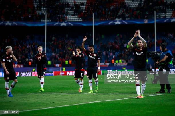 Roberto Hilbert of Bayer Leverkusen and his teammates Leon Bailey Kevin Volland Julian Brandt and Kevin Kampl acknowledge the audience their fans...
