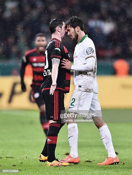 Roberto Hilbert of Bayer Leverkusen and Santiago Garcia of Werder Bremen clash during the DFB Cup Quarter Final match between Bayer Leverkusen and...