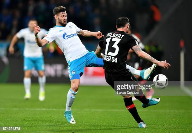 Roberto Hilbert of Leverkusen and Daniel Caligiuri of Schalke battle for the ball during the Bundesliga match between Bayer 04 Leverkusen and FC...