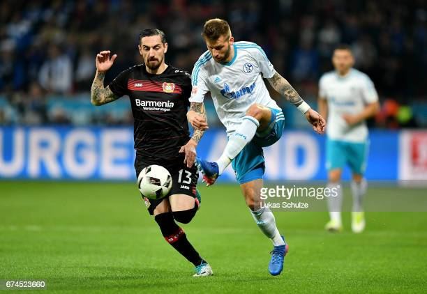 Roberto Hilbert of Leverkusen and Guido Burgstaller of Schalke battle for the ball during the Bundesliga match between Bayer 04 Leverkusen and FC...