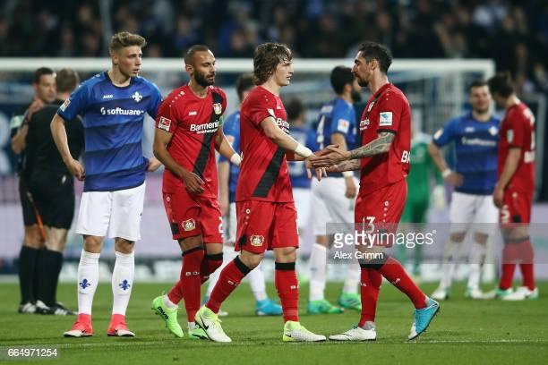 Roberto Hilbert Tin Jedvaj and Oemer Toprak of Leverkusen celebrate after the Bundesliga match between SV Darmstadt 98 and Bayer 04 Leverkusen at...