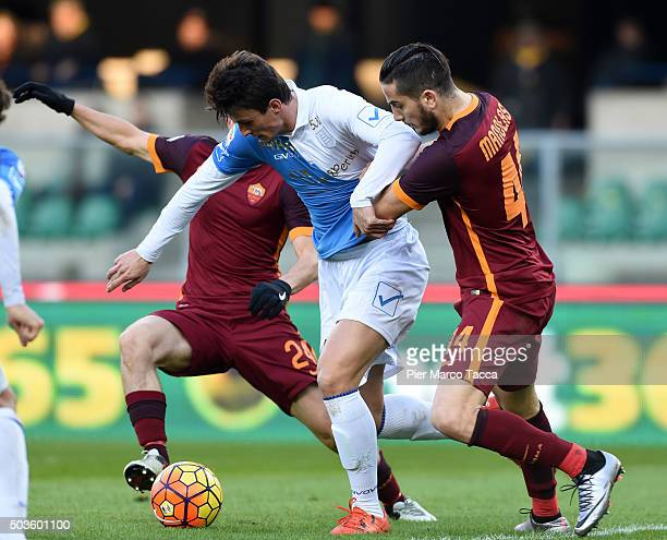 Roberto Inglese of AC Chievo competes for the ball with Kostas Manolas of AS Romaduring the Serie A match between AC Chievo Verona and AS Roma at...