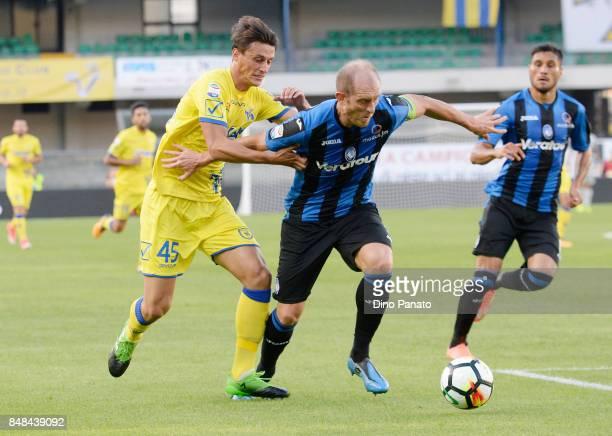 Roberto Inglese of AC Chievo Verona competes with Andrea Masiello of Atalanta BC during the Serie A match between AC Chievo Verona and Atalanta BC at...