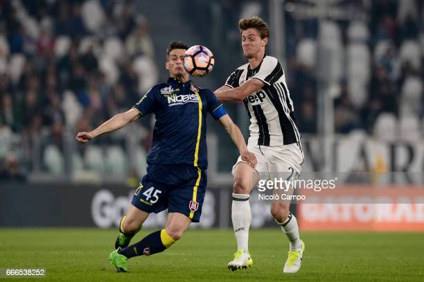 Roberto Inglese of AC ChievoVerona and Daniele Rugani of Juventus FC compete for the ball during the Serie A football match between Juventus FC and...