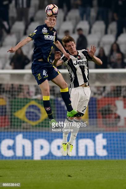 Roberto Inglese of AC ChievoVerona and Daniele Rugani of Juventus FC compete for a header during the Serie A football match between Juventus FC and...