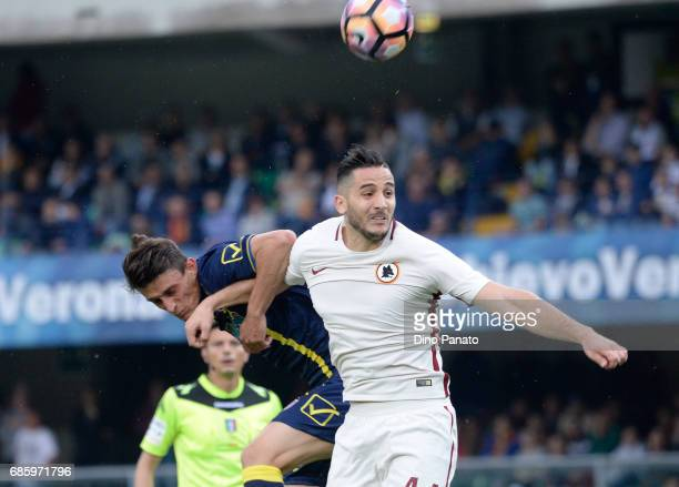 Roberto Inglese of AC ChievoVerona battles for an aerial ball with Kostantinos Manolas of AS Roma during the Serie A match between AC ChievoVerona...