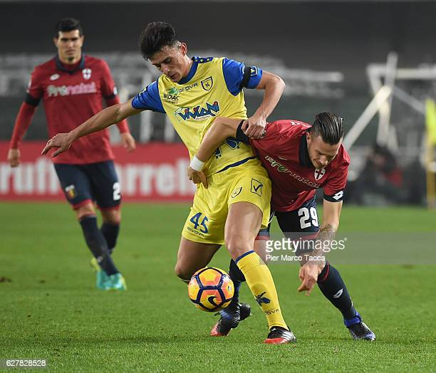 Roberto Inglese of AC ChievoVerona competes for the ball with Riccardo Fiamozzi of Genoa CFC during the Serie A match between AC ChievoVerona and...