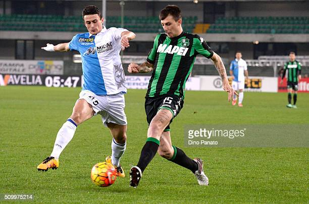 Roberto Inglese of Chievo Verona competes with Francesco Acerbi of US Sassuolo during the Serie A match between AC Chievo Verona and US Sassuolo...