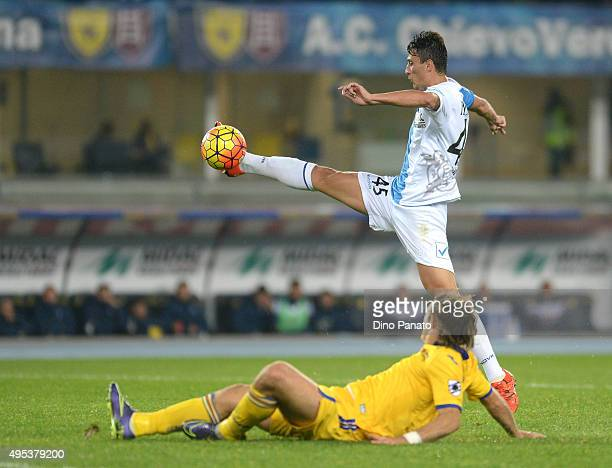 Roberto Inglese of Chievo Verona competes with Matias Silvestre of UC Sampdoria during the Serie A match between AC Chievo Verona and UC Sampdoria at...