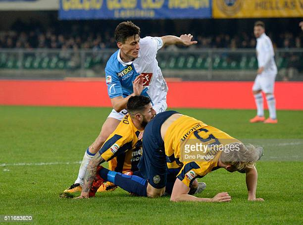 Roberto Inglese of Chievo Verona is challenged to Eros Pisano and Filip Helander of Hellas Verona competes with during the Serie A match between...